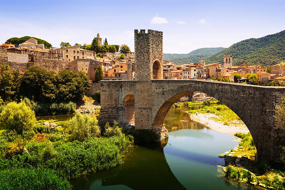 Cities in La Garrotxa span a region comprising protected lands, urban areas and industry