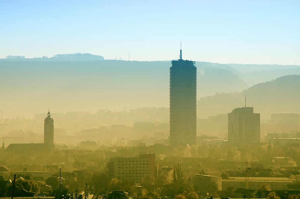 Skyline of Jena, Germany, in dusty morning
