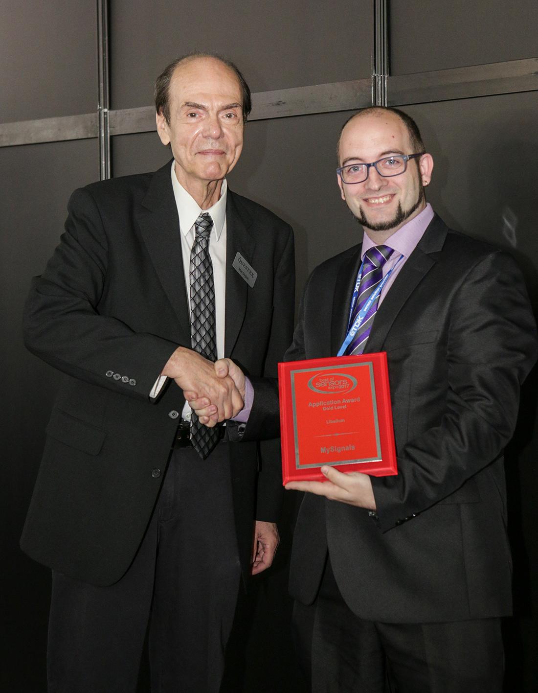 David Bordonada receiving BOSE Awards to MySignals from Mat Dirjish