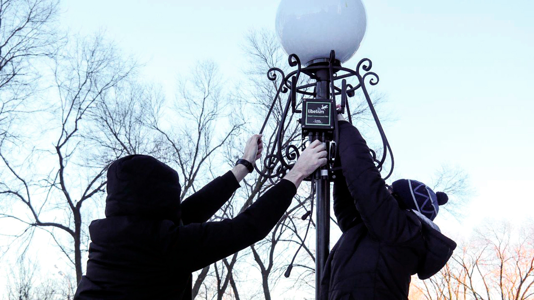 Airalab team installing one of the Plug&Sense! Smart Environment PRO